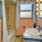 This colorful, sparkling-clean mid-century bathroom serves the main floor.