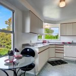 The bright, sparkling clean kitchen with eating space enjoys territorial views to the north and east.