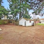 Situated on a large 6100 Sq Ft lot with alley access, the possibilities abound.
