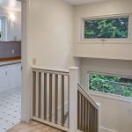 This day-lit staircase features 2 picture windows for plenty of natural light, lead upstairs to 3 large bedrooms sharing the floor.