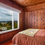 The north bedroom has the best views in the house, looking across Lake Washington to Mount Baker, Mercer Island, and the mountains.
