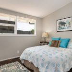 All three bedrooms feature vaulted ceilings, giving them a more spacious feeling, with more natural light. This is the first south-facing bedroom, across the hall from the main bathroom.