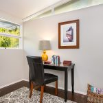 The smaller 3rd bedroom or office space faces north toward the street with its own powder room, vaulted ceiling, and plenty of glass for natural light.