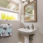 The newly renovated main bathroom serves both of the large south-facing bedrooms.