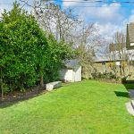 The private, level back yard, is great for gardening projects, a play area, barbeques, whatever you need.