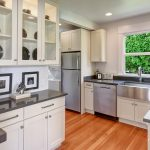 A Kitchen Re-Imagined (2017) This beautiful kitchen was re-imagined in 2017. A full, studs-out re-model, including quartz countertops, maple cabinets with dovetail drawers, Bloom hardware, stainless steel appliances, gas range, vented hood, Butler's Pantry, and more. The kitchen door accesses a private level back yard and the alley parking for easy access.