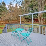 The back deck is just the place to relax and entertain, with serene views of the private, fenced, park-like back yard.