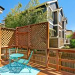 In the back, you'll find the perfect place to decompress, relax, or entertain on the private back deck.