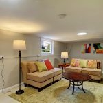 The daylight basement features a 380-square-foot finished recreation room with...