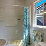 ...this sunny Continental bathroom with classic laundry chute.