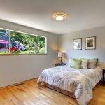 The extra-large master bedroom features beautifully preserved doors and trim and faces west toward the front garden with the mature Japanese maple tree for plenty of light well into the evenings.