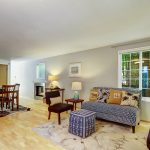 Open main floor welcomes with newly refinished hardwoods, big windows for plenty of natural light, and a flexible layout. Sellers sometimes used a shelving unit to create another wall.