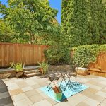 The tidy, private, fully-fenced and hardscaped patio is perfect for relaxing and entertaining.