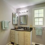 Main bathroom has exceptional water pressure in the shower, dual-flush toilet, and medicine cabinet behind the corner mirror.