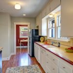 The kitchen connects with the central hallway, and...