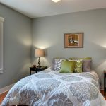 ...the main bedroom offers a bit more space, also with a south-facing window for plenty of light into the evening.