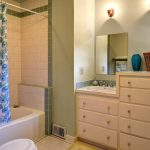 The stylish bathroom features subway tiles and original built-ins.