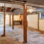 Accessed from the staircase outback, the 690 square foot unfinished daylight basement, is perfect for use as storage space, a workshop, or a studio.