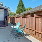The fenced private hardscaped patio is the just place to relax or entertain, conveniently accessed from the kitchen via the laundry room.
