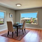 The formal dining and living rooms have large picture windows, flooding the spaces with natural light, and serene Cascade Mountain and territorial views. Newly-refinished original fir floors blanket most of the home with warmth.
