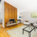 A sleek floor-to-ceiling wood-paneled fireplace brings warmth to those chilly winter nights.