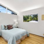 The second bedroom gets plenty of morning light from the vaulted ceilings and window, and the south-facing window keeps the room illuminated well into the day.  The high ceilings make the room feel even more spacious.