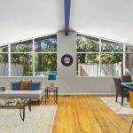 Bam! The 60's come rolling back with this stunning architectural design in the style of Paul Hayden Kirk. Soaring vaulted ceilings in the living and dining rooms showcase a wall of windows to bring the serene wooded outside in.