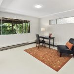 Opposite the family room is a bonus space, great for use for an office, study, workshop, studio, or storage.
