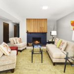 A second cosy wood-burning fireplace is the center of the space.