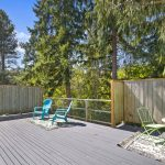 The wrap-around deck begins from the front of the house, passes by the kitchen door, and out to the main deck area providing a serene, treehouse feel, perfect for relaxing, entertaining, bird watching, or hot tubbing.