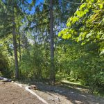 The lush 6,792 square foot lot slopes down into a wooded natural area where wildlife can be observed and the distant sound of Thornton Creek can be heard during heavy rains. Hummingbirds, owls, and other northwest native birds can be enjoyed year-round from the back deck.
