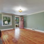 The living room is grand in size, with a great view of the front yard.