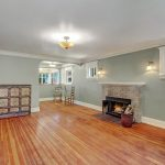 A home with charming details like original fir floors, crown molding and millwork, hand-blown light fixtures, solid fir doors, brass hardware, and glass doorknobs.