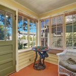The kitchen flows through to the cheerful sunroom, and out to the back deck.