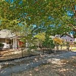UW Tacoma District 1925 craftsman bungalow tucked away on a quiet tree-lined street. The enchanting private wooded lot enjoys great Downtown to Commencement Bay views.