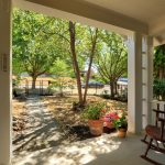 The rocking chair front porch is just the place to relax with a serene view of the lush green front grounds, even on rainy days.