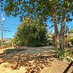 The back yard is fully fenced, with the potential to restore access from the alley, if a garage is ever reinstated.