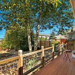 The private back deck features Trex decking and plenty of space for relaxing and entertaining with city and Commencement Bay views.