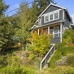 Majestic modern Craftsman perched peacefully up a sunny hillside.
