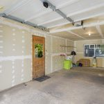 The garage is large enough to accommodate a full-size vehicle and bikes with room to spare. The large window provides natural light, making a great space for use as studio or workshop with level alley access.