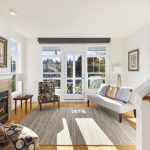 An inspired open floor plan with rocking chair porch into light-filled living and dining rooms.
