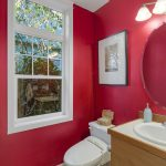 The main floor powder room is perfect for visiting guests.