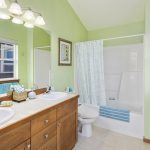 The master bathroom is bright and open as well, with a vaulted ceiling and three south-facing windows. This is a full bath with double vanity, great for busy people on the go.