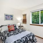 Relax in complete privacy with greenery from every window. The smallest bedroom of the three, the southeast bedroom also works well as an office or study.